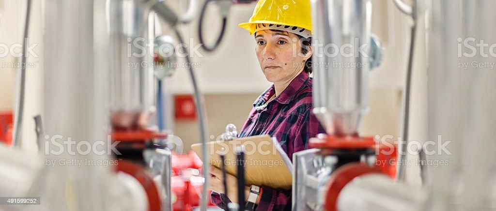 Female stationary engeneer at work stock photo
