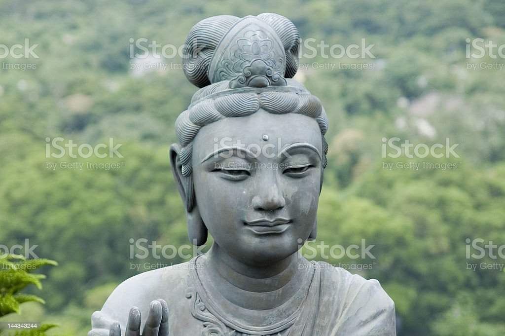 Female statue in front of a temple, providing offerings stock photo