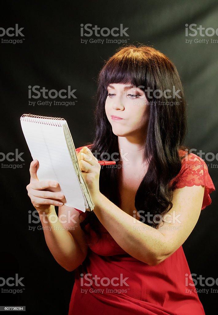 Female Stenographer Taking Notes stock photo