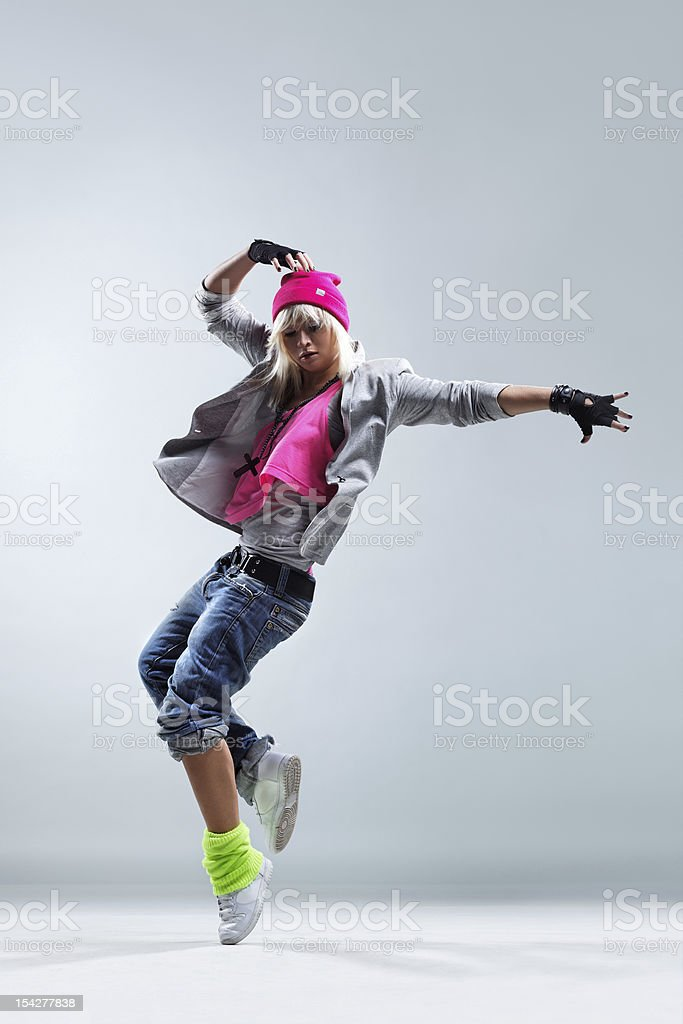 Female street dancer wearing colorful clothes stock photo