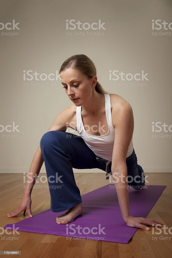 Female Stretching on a Yoga Mat royalty-free stock photo