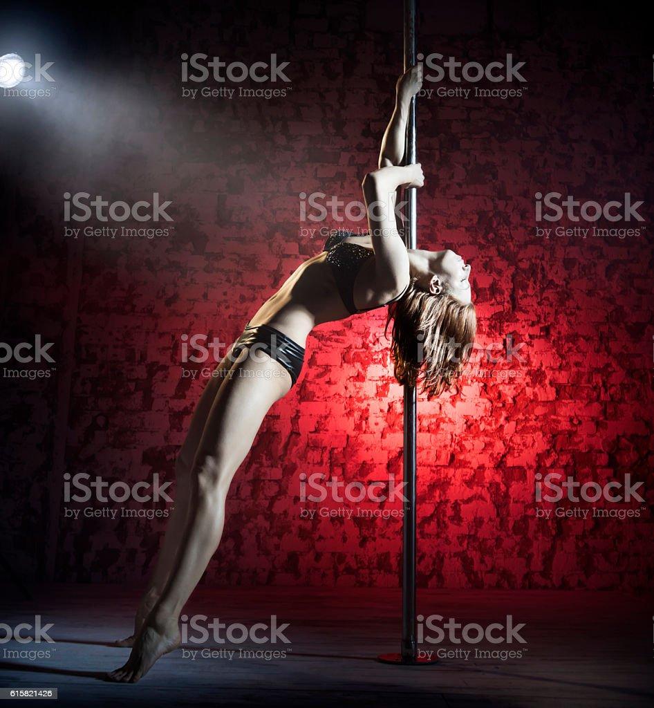 Female striptease on the pole stock photo