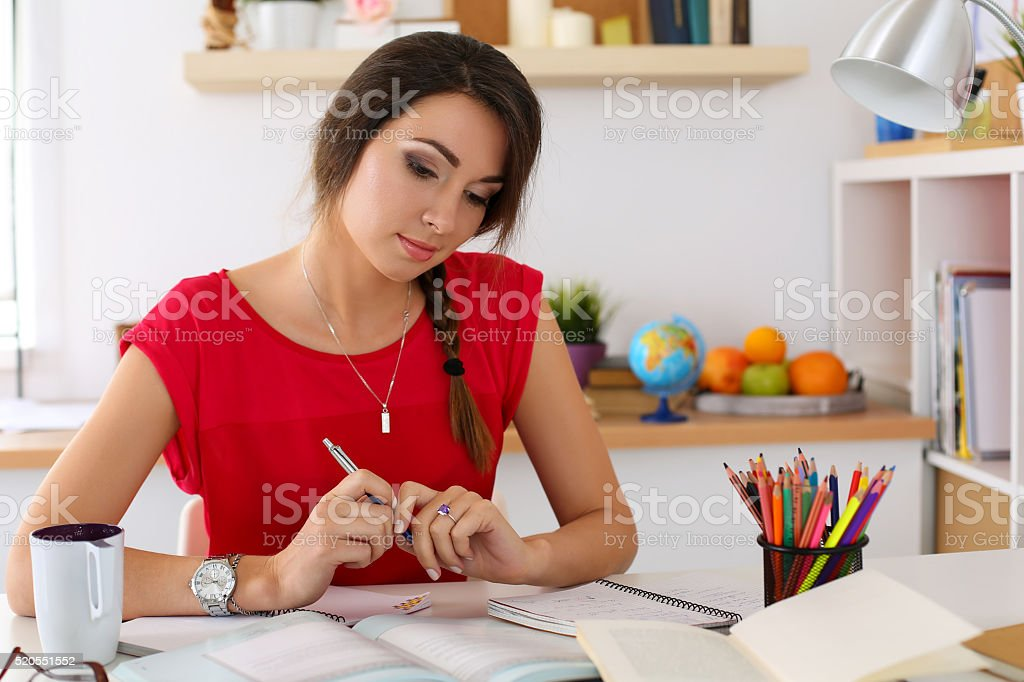 Female student at workplace stock photo