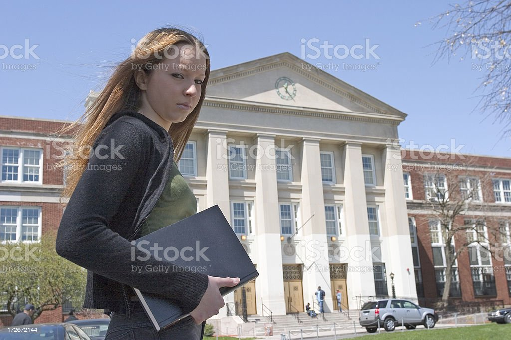 Female student by the school royalty-free stock photo