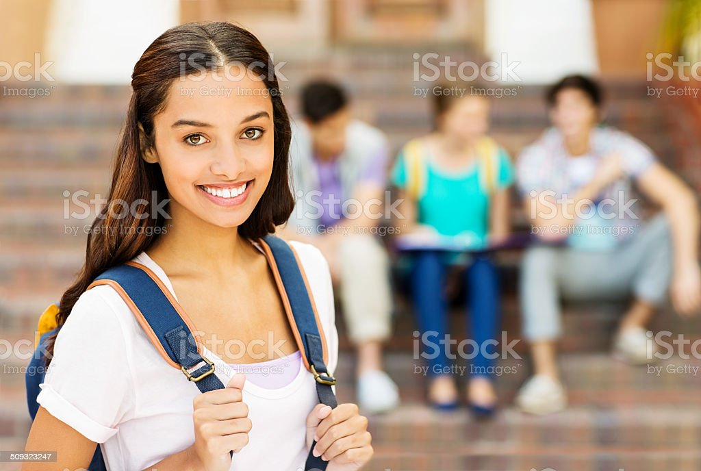 Female Student Carrying Backpack On University Campus stock photo