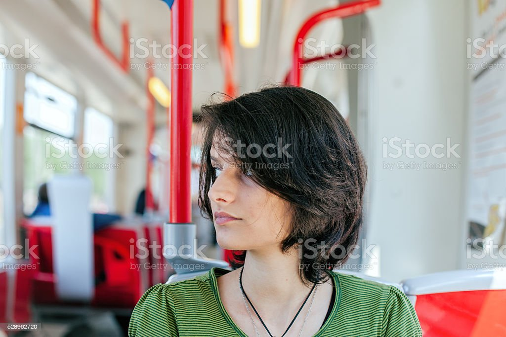 Female student commuting by public transportation royalty-free stock photo