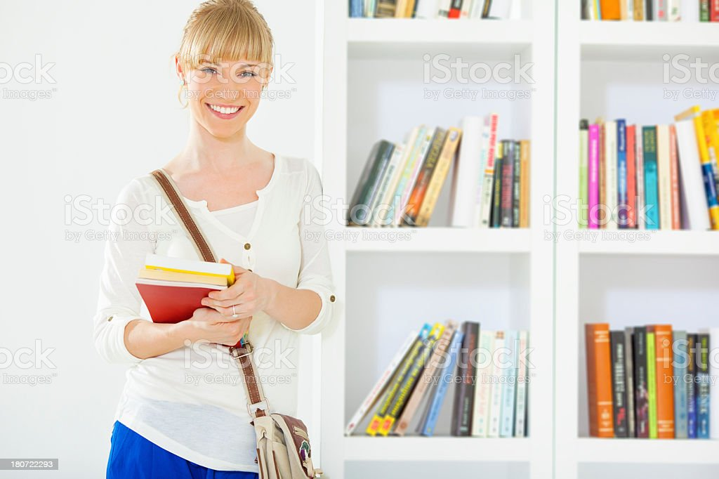 Female Student in a library. royalty-free stock photo