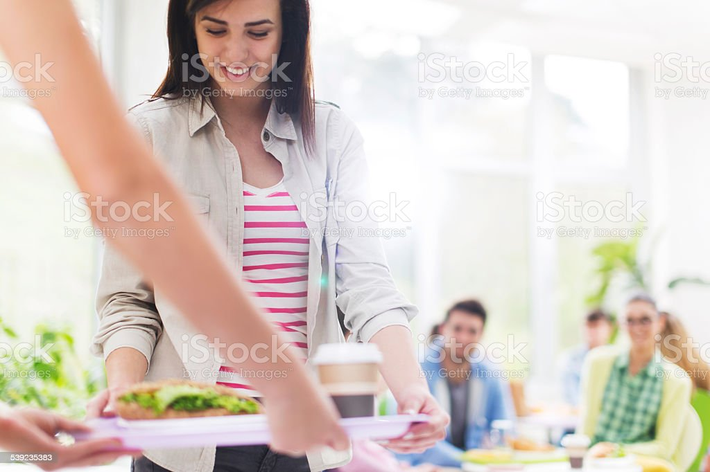 Female student in cafeteria. stock photo