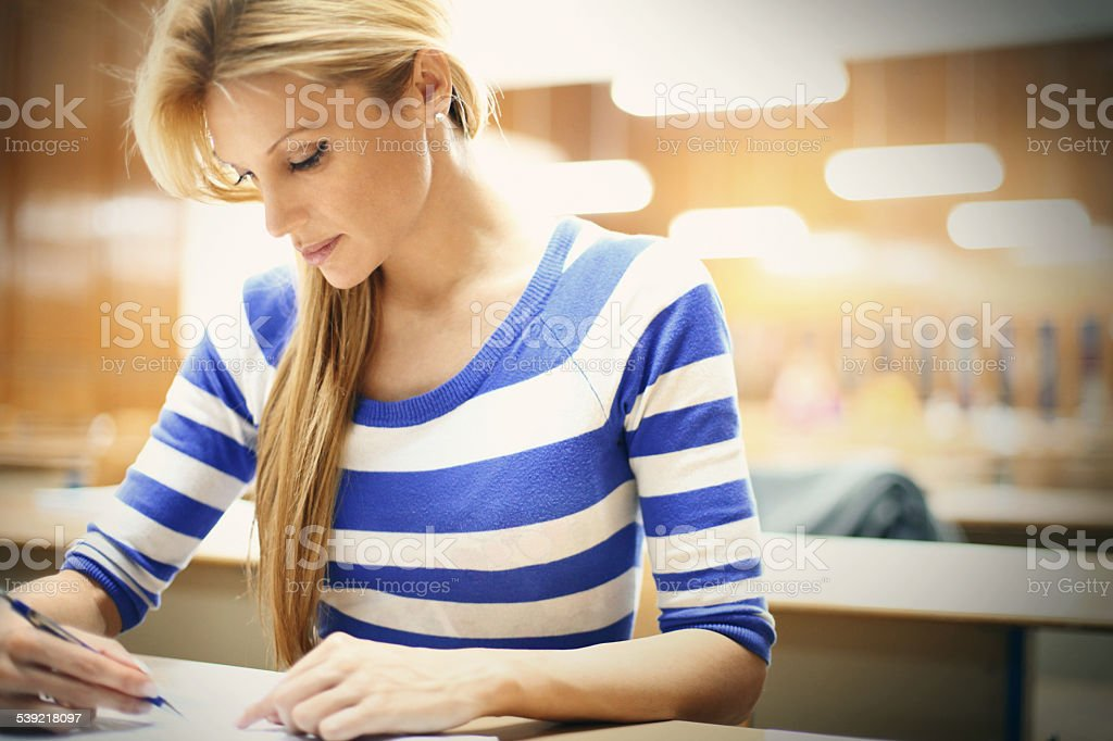Female student in class. stock photo