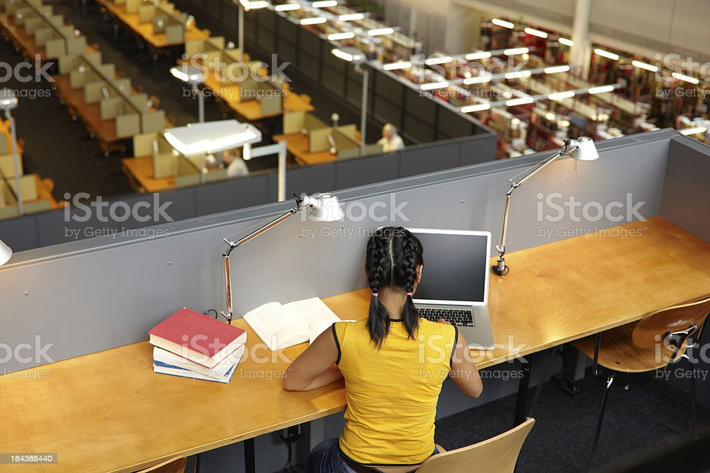 Female student in the academic library royalty-free stock photo