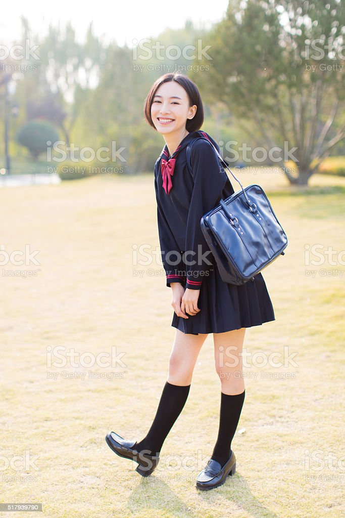 female student in the park stock photo