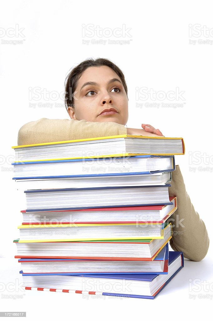 female student leaning on books stock photo