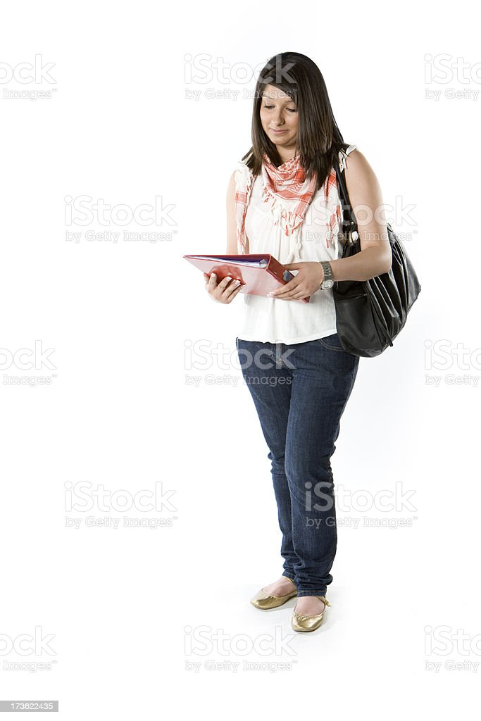 Female student looking at her work against  plane background royalty-free stock photo