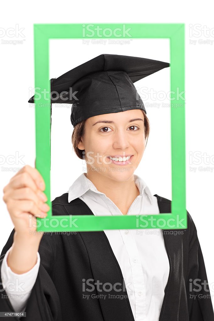 Female student posing behind a green picture frame stock photo