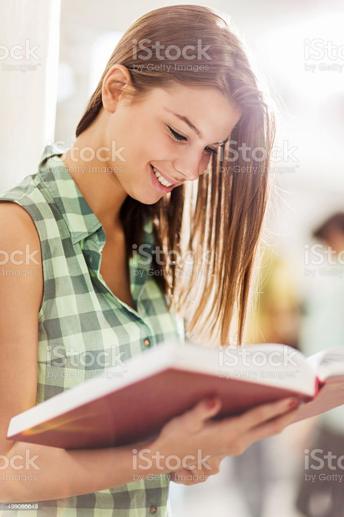Female student reading a book. royalty-free stock photo