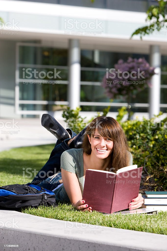 Female Student Reading on Campus royalty-free stock photo