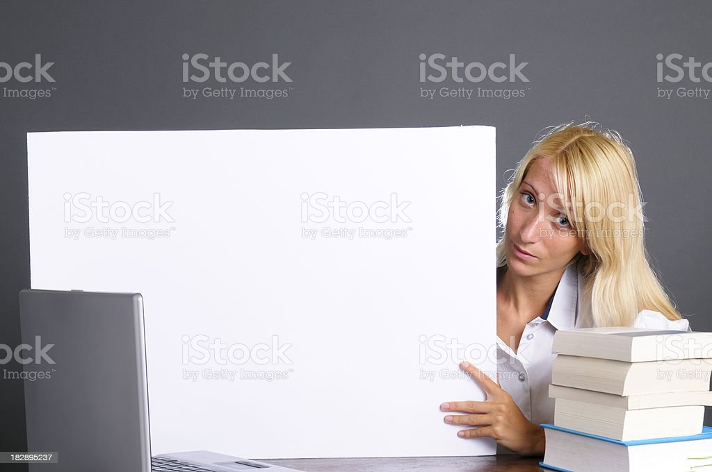 Female Student Showing Blank Sign.Copy Space royalty-free stock photo