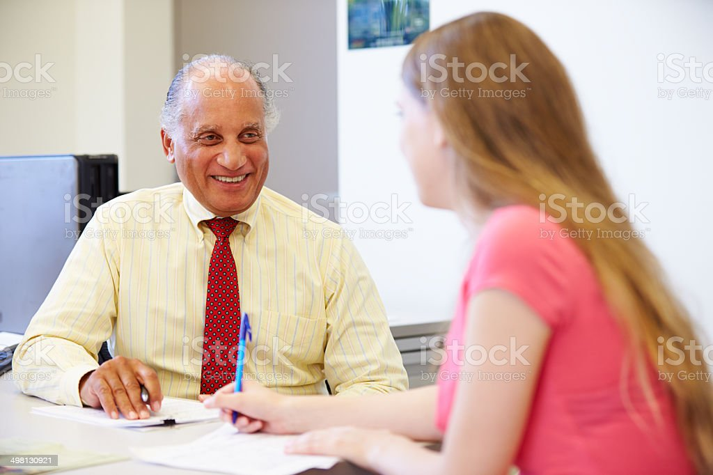Female Student Talking To High School Counselor stock photo