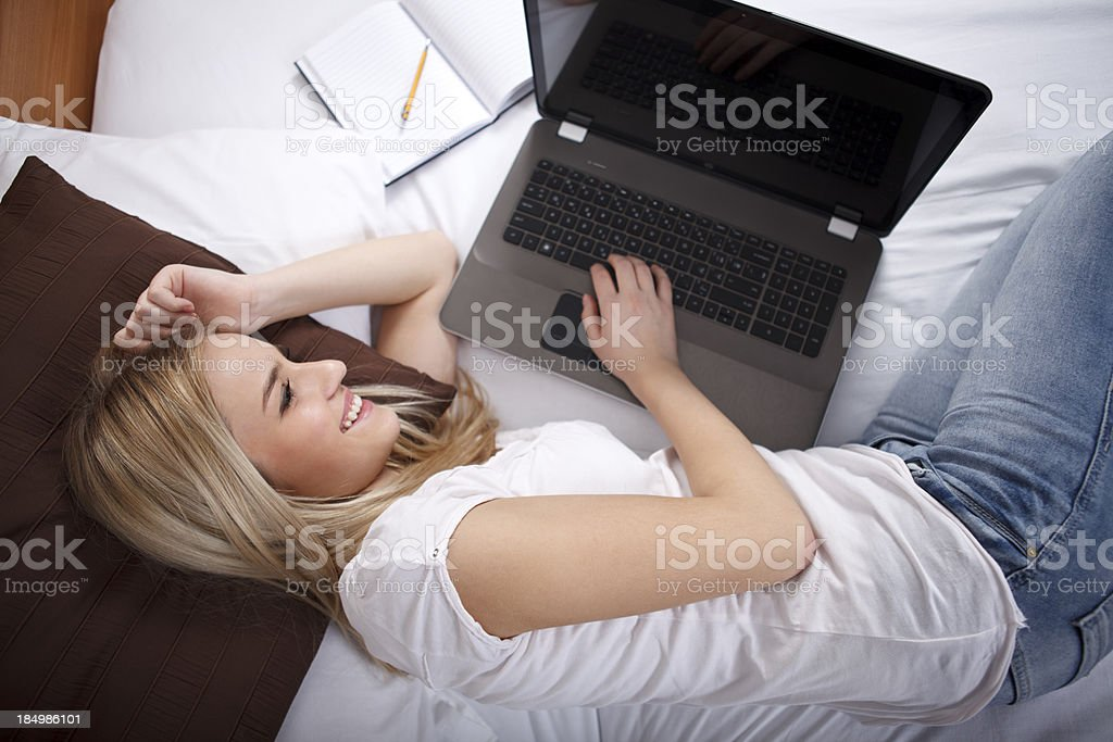Female student using laptop at home royalty-free stock photo