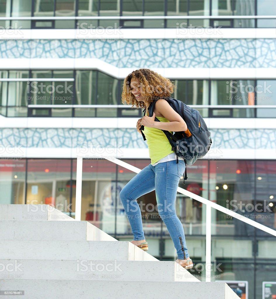 Female student walking on campus stock photo