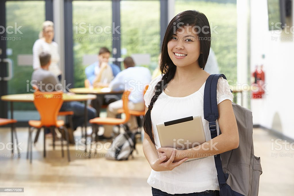 Female student with backpack in a cafeteria background stock photo