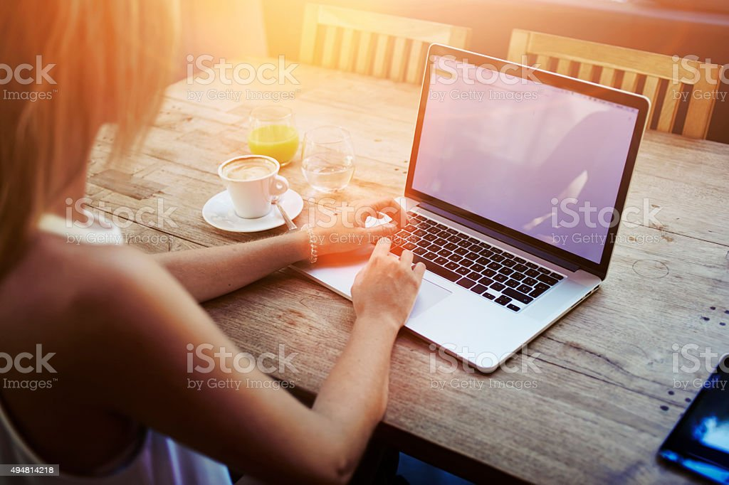 Female student working on net-book after her lectures in University stock photo