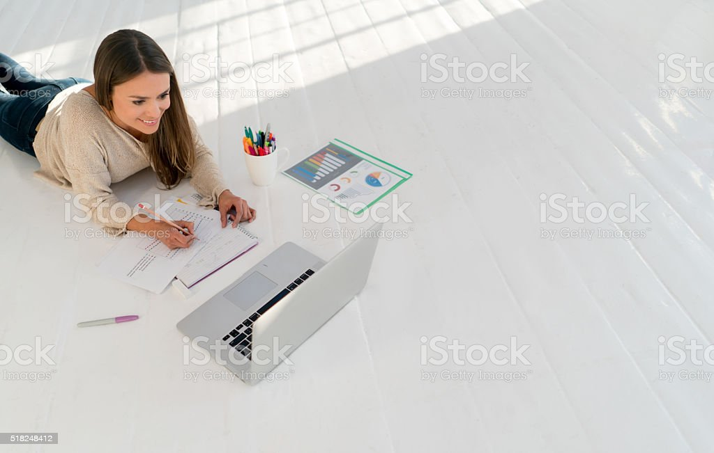 Female student working online at home stock photo