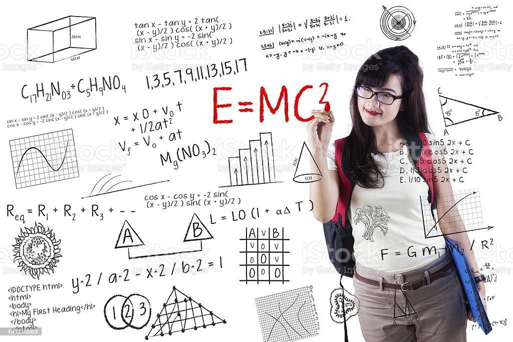 Female student writes formula stock photo