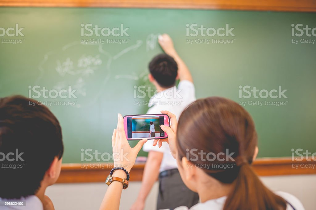 Female Student Writing Happy Words, Chinese and English, Hong Kong stock photo