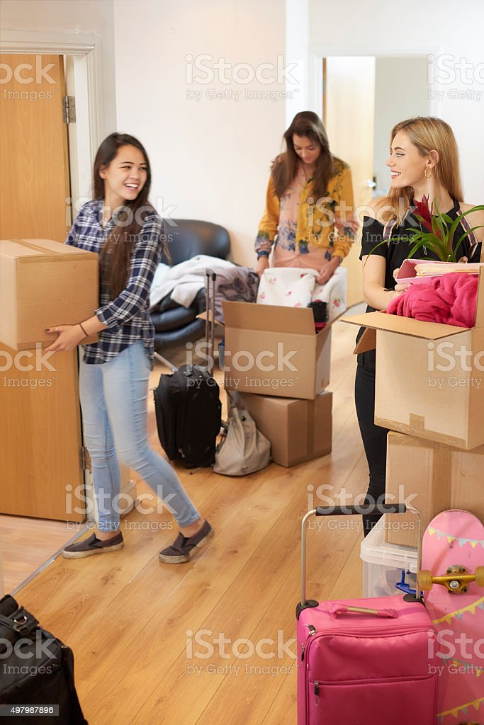 female students moving into new flat stock photo