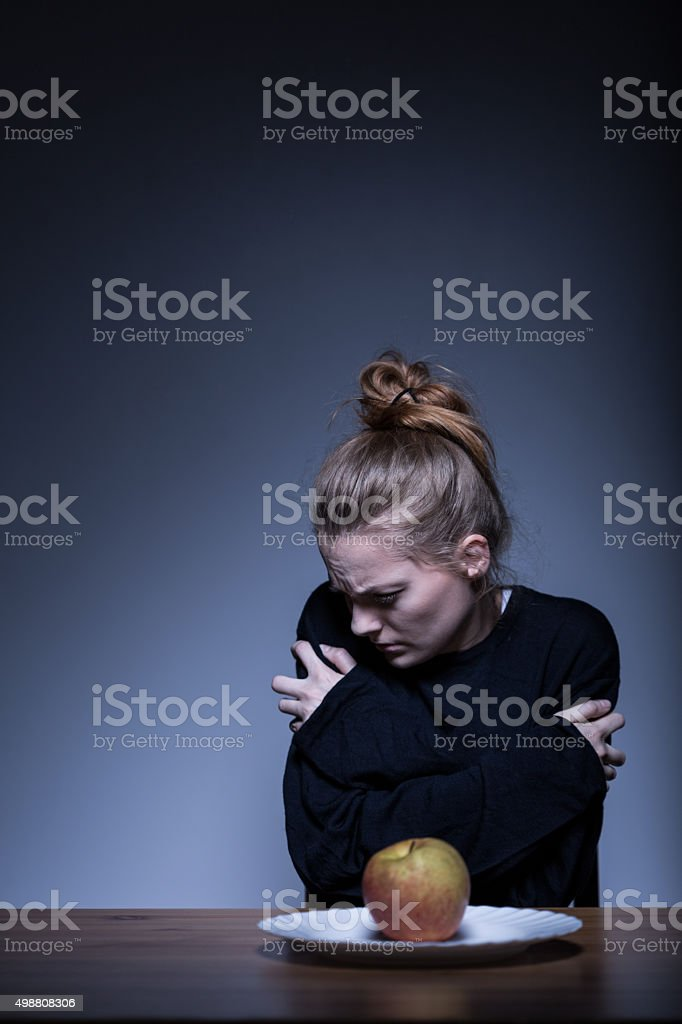 Female suffering from anorexia stock photo
