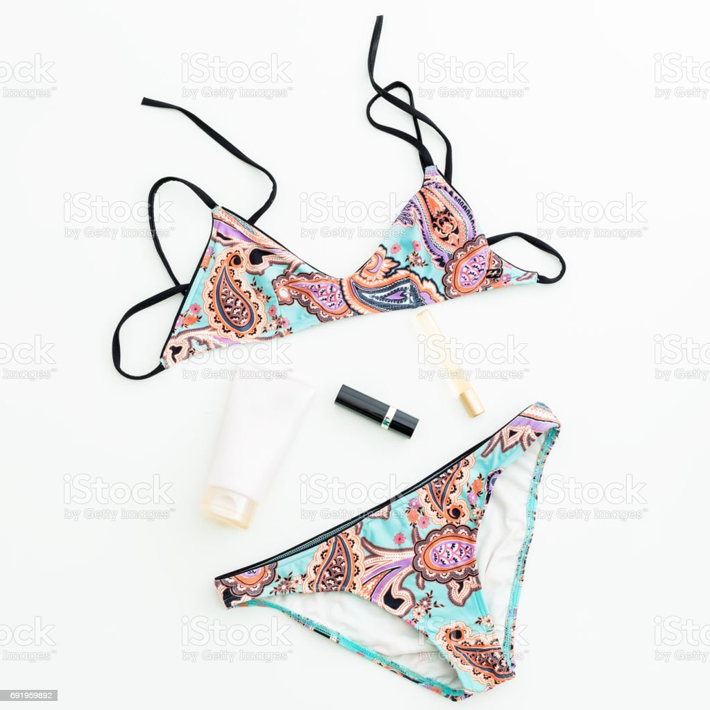 Female summer swimsuit. Flat lay, Top view stock photo
