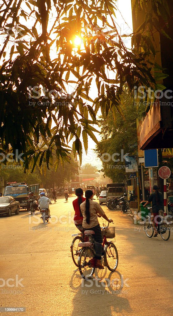 Female Sundown Cyclists royalty-free stock photo