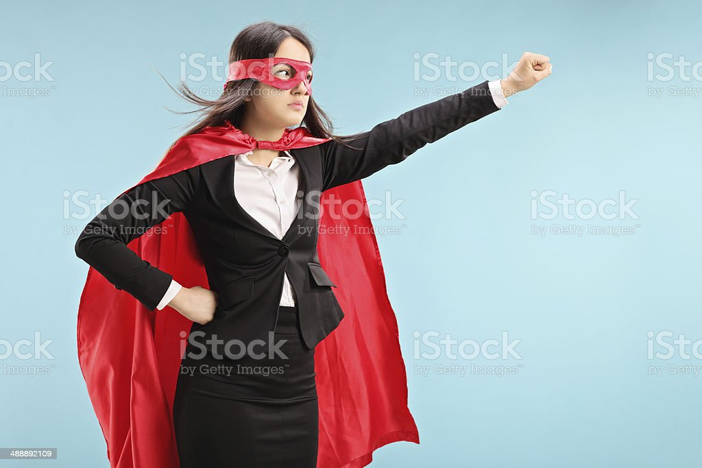 Female superhero with raised fist stock photo