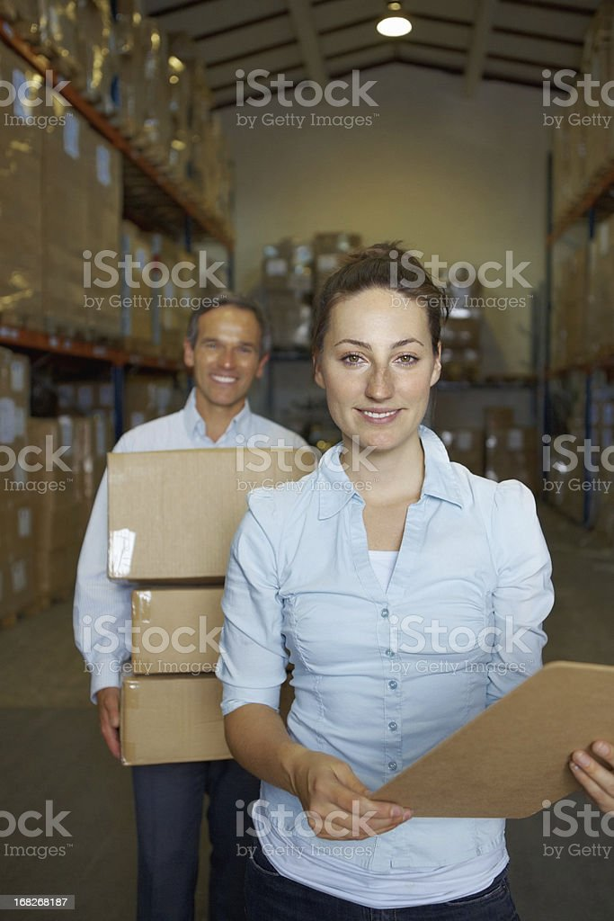 Female supervisor smiling with male coworker royalty-free stock photo