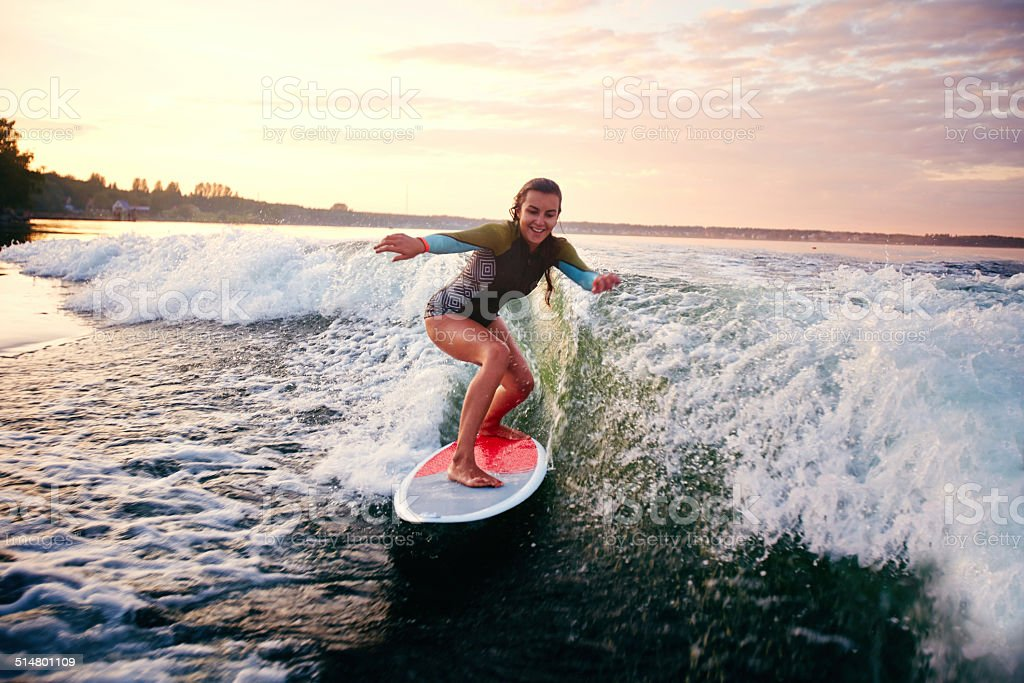 Female surfboarder stock photo