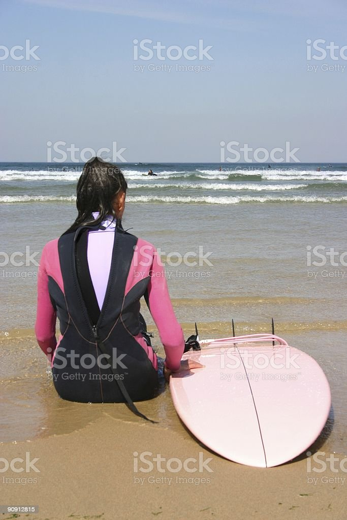 female surfer looking at the waves royalty-free stock photo