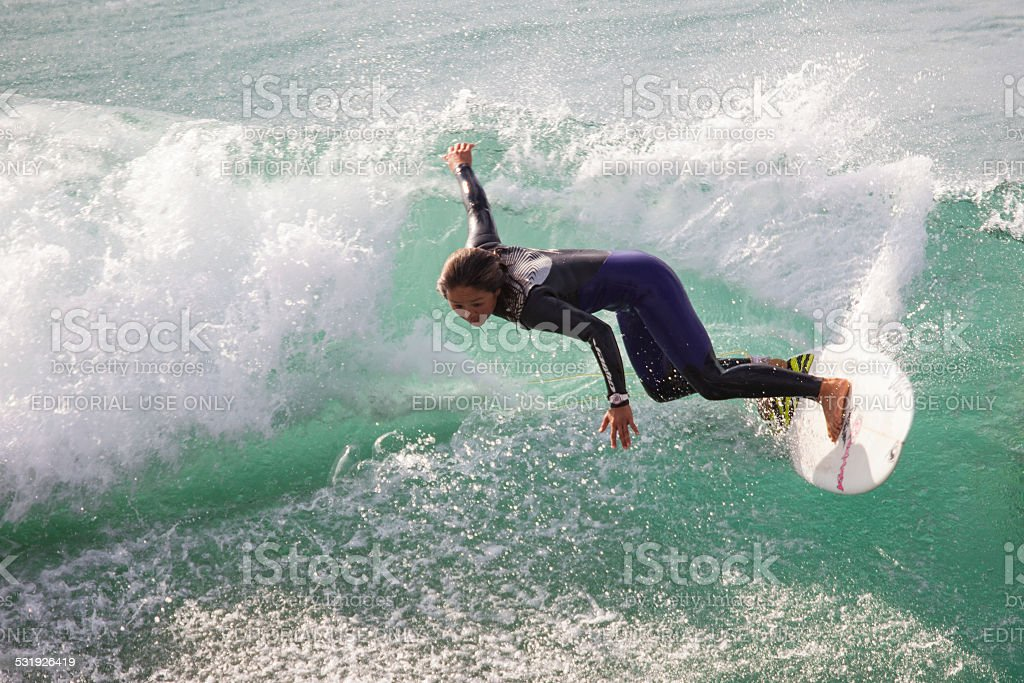 Female surfer on a wave at Oceanside California stock photo