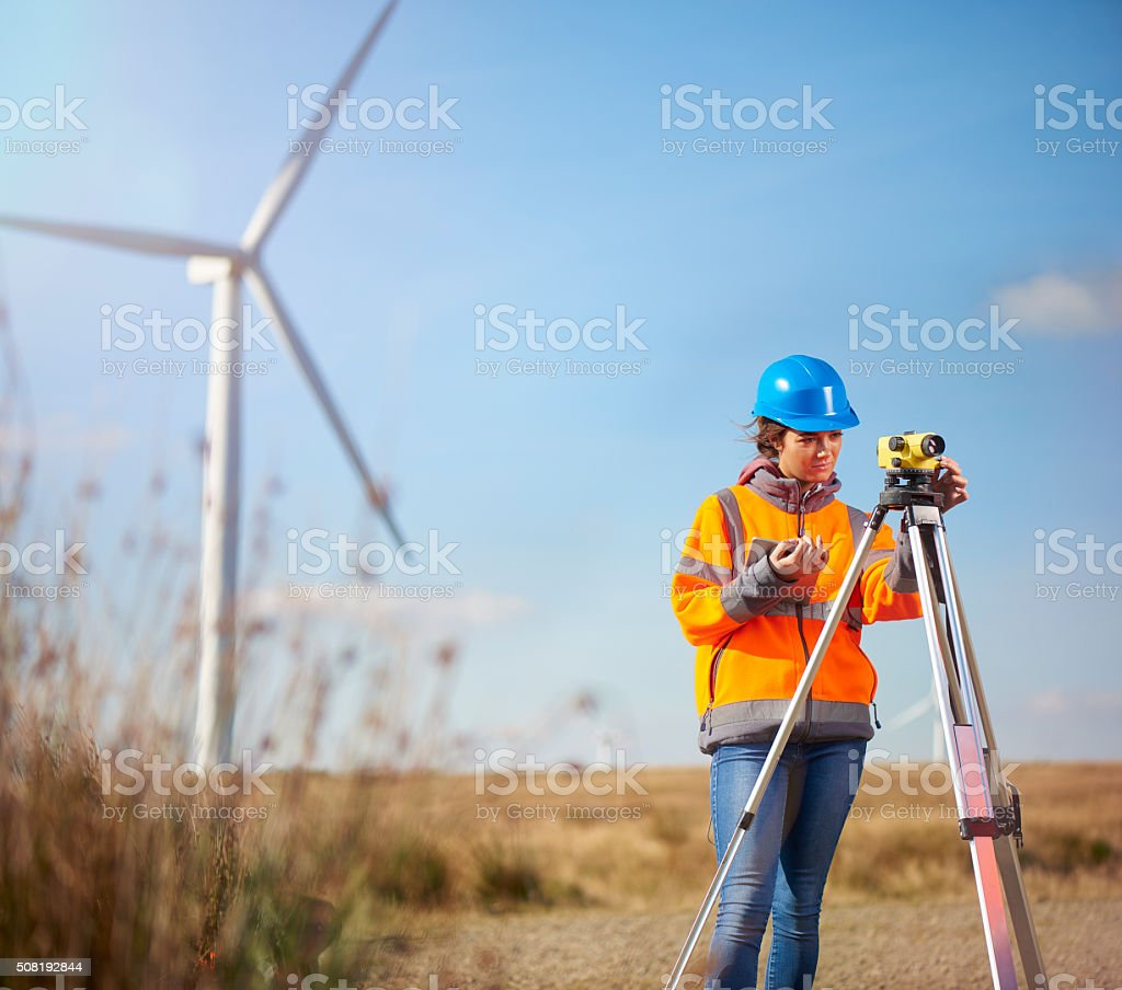 female surveyor on a windfarm stock photo