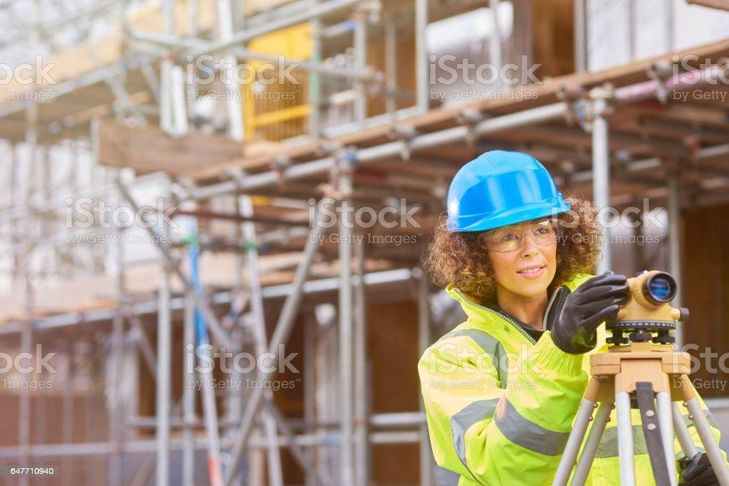 female surveyor on construction site stock photo