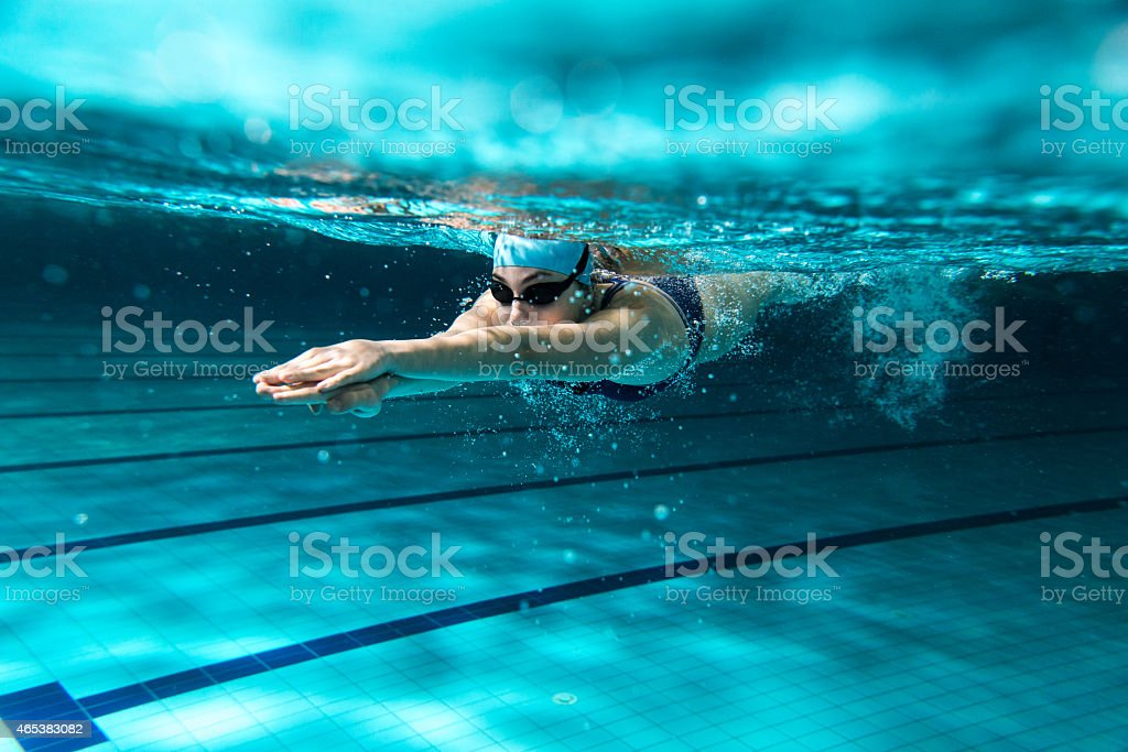 Female swimmer at the swimming pool. royalty-free stock photo