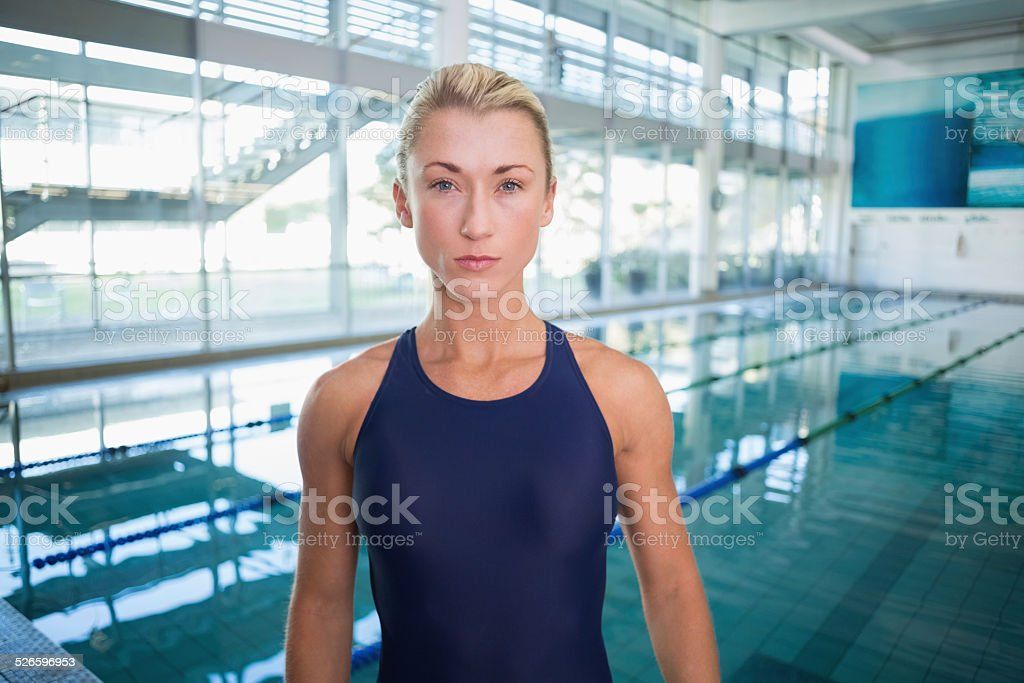 Female swimmer by pool at leisure center stock photo