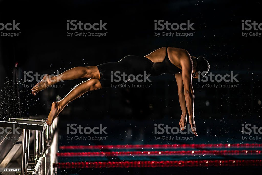 Female Swimmer In Mid-Air stock photo