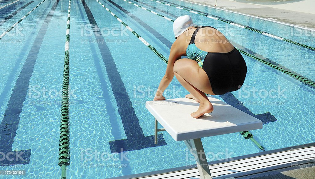 Female Swimmer in Start Block stock photo