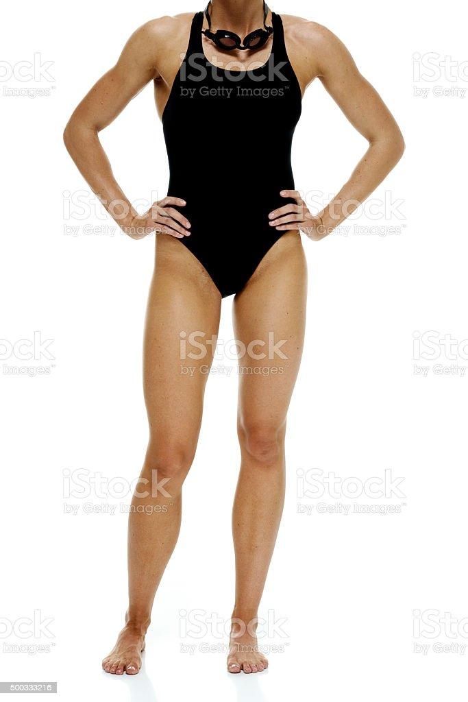 Female swimmer standing stock photo
