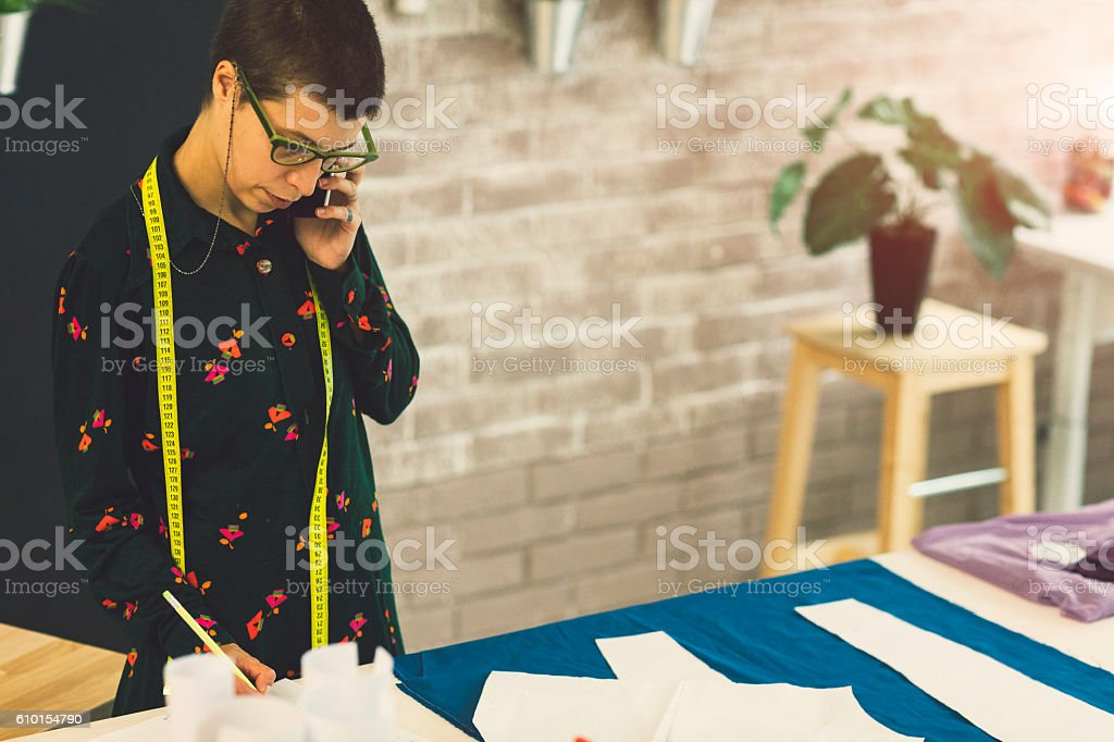 Female Tailor Coloring Book And Talking On The Phone. stock photo