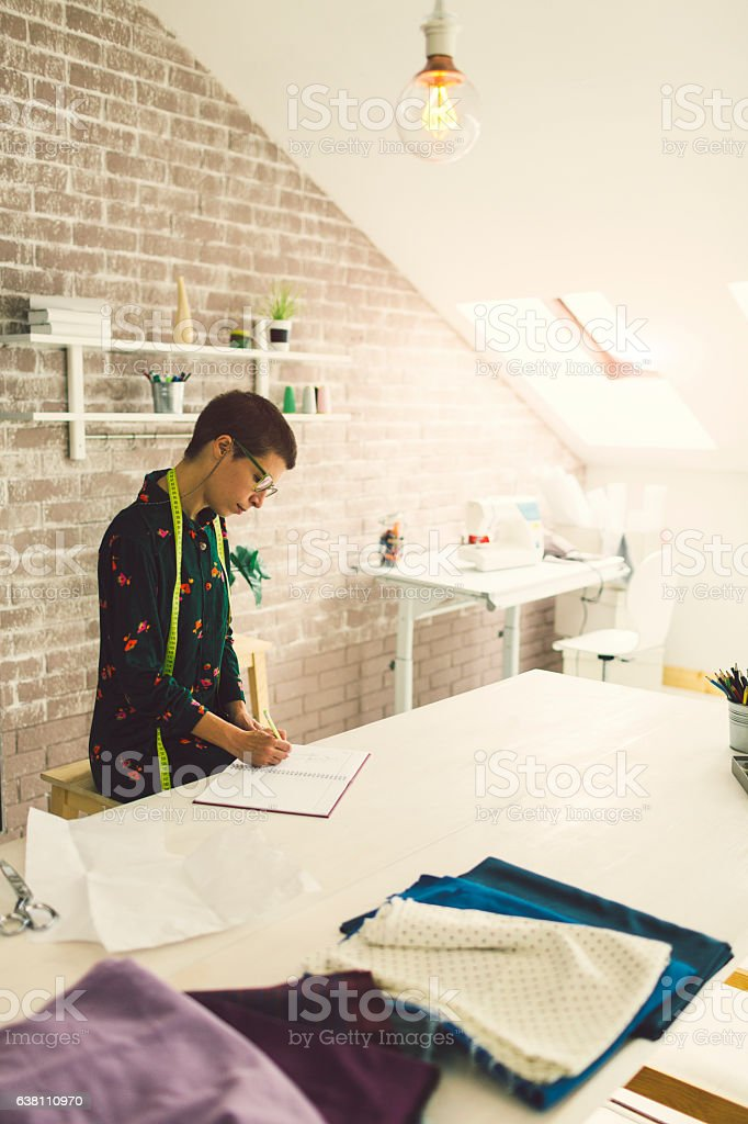 Female Tailor In Her Workshop stock photo