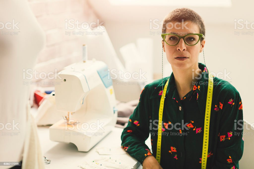 Female Tailor In Her Workshop. stock photo
