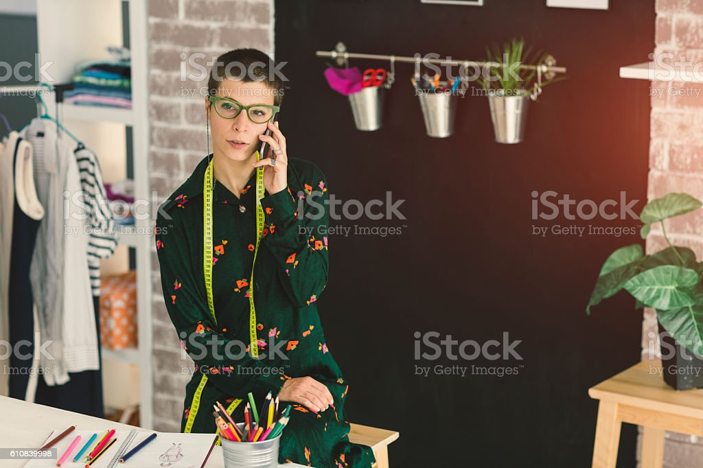 Female Tailor Talking On The Phone. stock photo