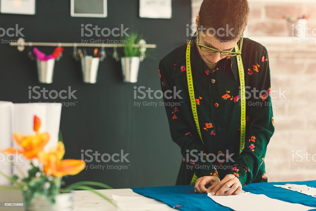 Female Tailor Working In Her Workshop stock photo